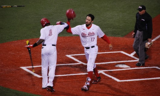 OSU junior left fielder Ronnie Dawson (4) and redshirt junior right fielder Jacob Bosiokovic (17) celebrate at the plate during a 9-8 win over Toledo on March 30 at Bill Davis Stadium. Credit: Edward Sutelan | For The Lantern
