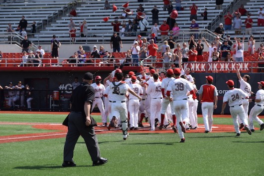 OSU players celebrate redshirt junior right fielder Jacob Bosiokovic's walk-off home run to beat Northwestern 5-4 on March 27 at Bill Davis Stadium. Credit: Giustino Bovenzi | Lantern reporter