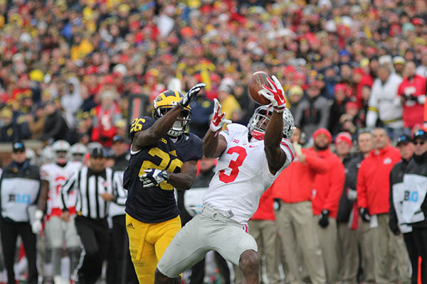 Then-OSU wide receiver Michael Thomas (3) makes a catch during a game against Michigan on Nov. 28 at Michigan Stadium in Ann Arbor, Michigan. Samantha Hollingshead | Photo Editor