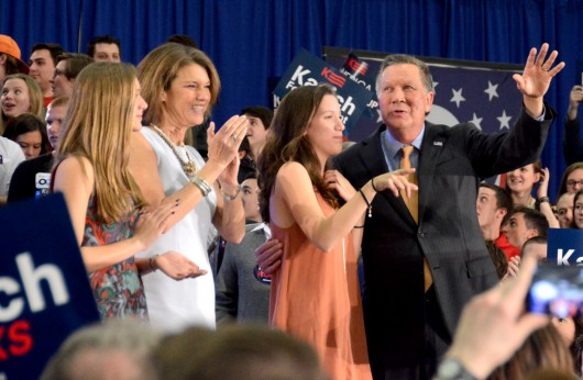 Ohio Gov. John Kasich (right), accompanied by his family, waves to the crowd at Baldwin Wallace University after winning Ohio's Republican primary on March 15. Credit: Kevin Stankiewicz | Asst. Sports Editor