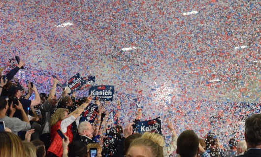 Supporters of Ohio Gov. John Kasich celebrate his victory in the Ohio Republican primary as confetti is released into the air at an election watch party at Baldwin Wallace University in Berea, Ohio. Credit: Kevin Stankiewicz | Asst. Sports Editor