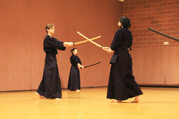 Cole Judge (left) and Justin Angra practice the different movements of kendo while at practice in the RPAC on February 25th, 2016.