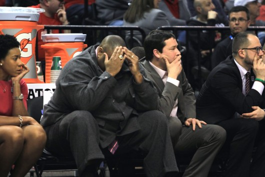 Ohio State coaches Mark Mitchell (left) and Kevin McGuff (right) watch OSU's 82-63 loss to Michigan State in the Big Ten tournament. Credit: Kevin Stankiewicz | Asst. Sports Editor