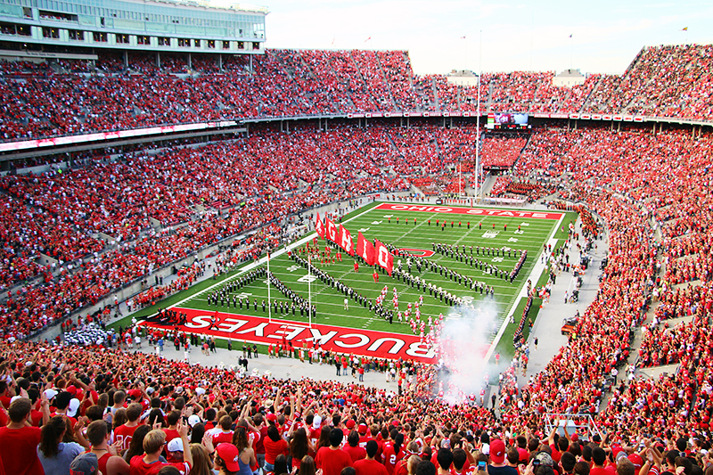 Fans cheer as players run onto the field at Ohio Stadium before a game. Credit: Lantern file photo