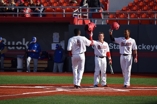 Ronnie Dawson (4) touches home plate following a home run during OSU's 12-1 win over Hofstra on March 18 at Bill Davis Stadium. Credit: Giustino Bovenzi | Lantern reporter