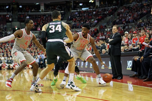 OSU freshman guard JaQuan Lyle (13) controls the ball during a game against Michigan State on Feb. 23 at the Schottenstein Center. Credit: Samantha Hollingshead | Photo Editor