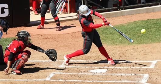 OSU redshirt senior first baseman Erika Leonard (15) swings at a ball. Credit: Courtesy of OSU