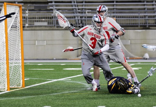 OSU redshirt junior goalie Tom Carey (3) tries to recover a ground ball during a game against Marquette on March 4 at Ohio Stadium. Credit: Jenna Leinasars | Multimedia Editor