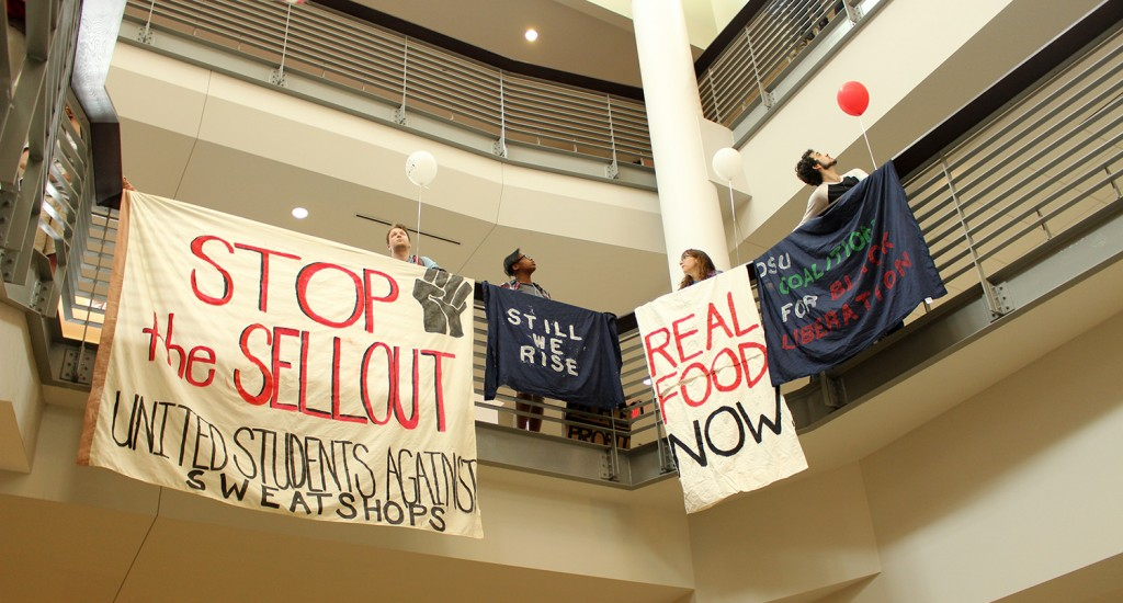 Protesters made a stop in the Ohio Union to reveal banners that express their grievances with Ohio State's proposed privatized energy plan on April 21. Credit: Hannah Herner   Assistant Arts&Life Editor