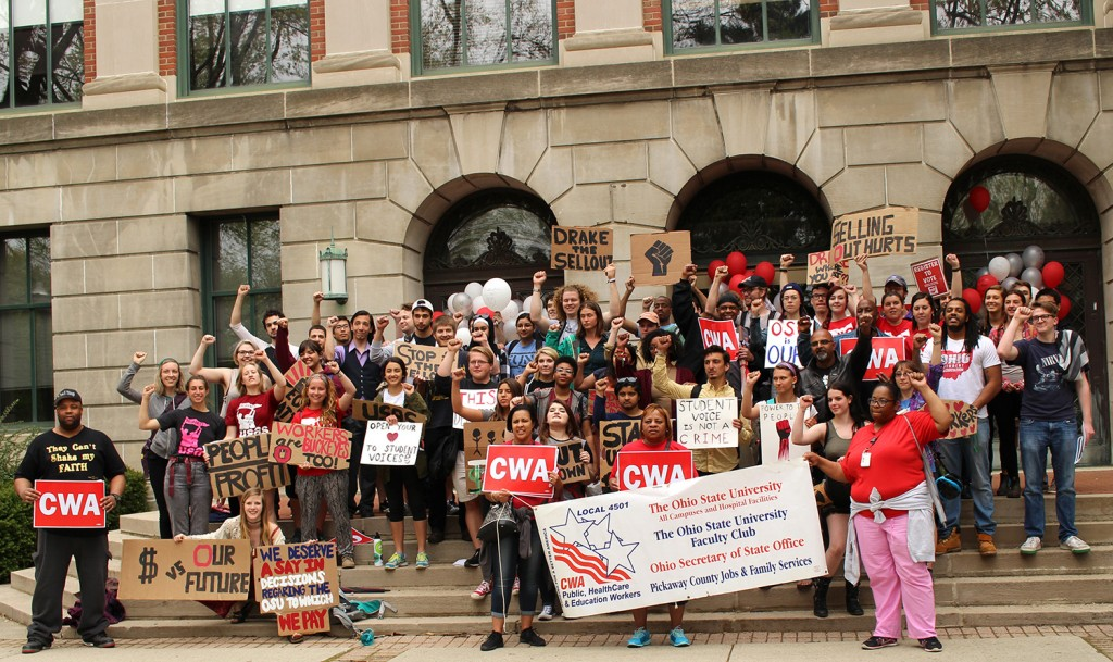 Protesters pose for a photo outside of Bricker Hall after speakers expressed their concerns. Credit: Hannah Herner   Assistant Arts&Life Editor