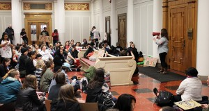 Ohio State students join together in front of President Michael Drake's office during in a sit-in at Bricker Hall on April 6. Credit: Mitch Hooper | Lantern reporter