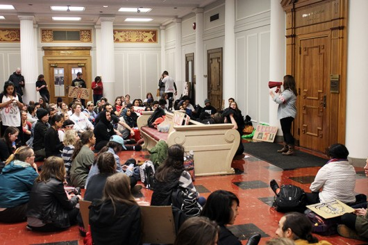 Ohio State students join together in front of President Michael Drake's office during in a sit-in at Bricker Hall on April 6. Credit: Mitch Hooper / For The Lantern
