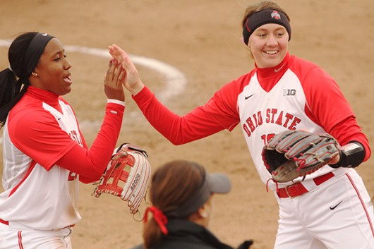 OSU sophomore Taylor White (21) and junior Shelby Hursh (19) in a game against Penn State on April 6 at Buckeye Field. Credit: Lantern File Photo