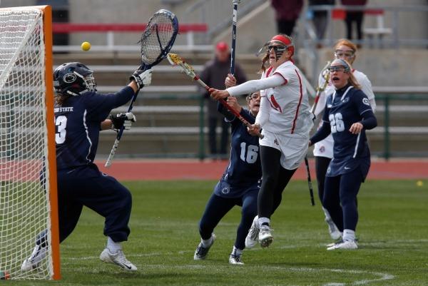 OSU senior attacker Cian Dabrowski (14) fires a shot in a game against Penn State on April 9. OSU won, 16-13. Credit: Courtesy of OSU