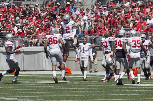 OSU redshirt sophomore safety Marshon Lattimore (2) celebrates his interception with teammates during the spring game on April 16 at Ohio Stadium. Credit: Alexa Mavrogianis | Lantern photographer