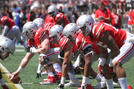 OSU's scarlet offensive line gets set during the spring game on April 16 at Ohio Stadium. Credit: Lantern File Photo