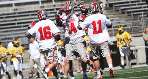 OSU players celebrate after a goal during a game against Michigan on April 16 at Ohio Stadium. Credit: Samantha Hollingshead | Photo Editor