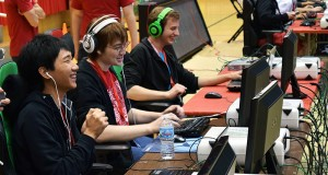 """(Left to right) Kevin Zhao, Alex Williams and Donny  Campbell, members of the Ohio State """"League of Legends"""" team, play the game together at the AllMid tournament in Cincinnati on October 3. Credit: Robert Scarpinito 