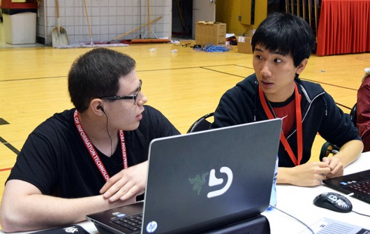 "Gerald Richland (left) and Kevin Zhao, members of Ohio State's ""League of Legends"" team, discuss strategies at the AllMid tournament in Cincinnati on Oct. 3. Credit: Robert Scarpinito 