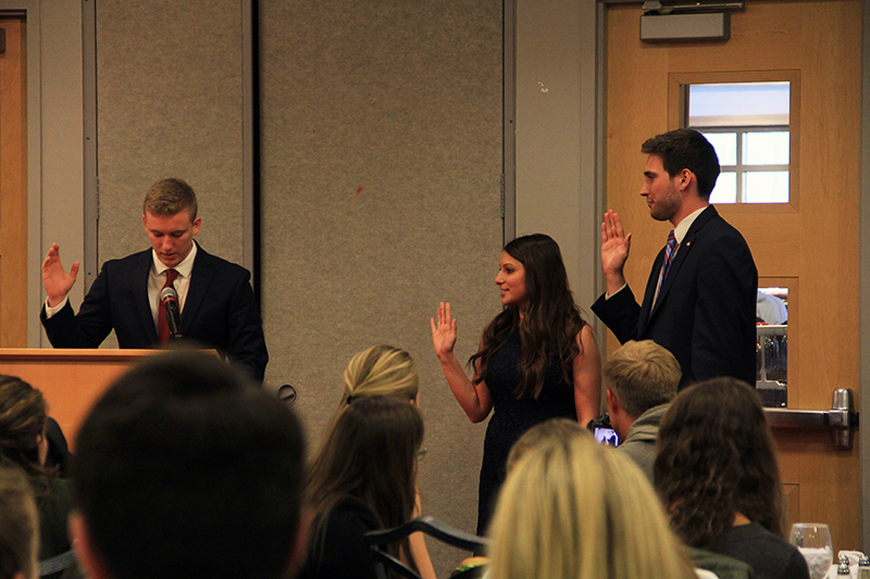 Student Government Vice President Danielle Di Scala (center) and President Gerard Basalla (right) swear in during the 2016 USG Inauguration on April 5 at the Ohio Union. Credit: Samantha Hollingshead | Photo Editor