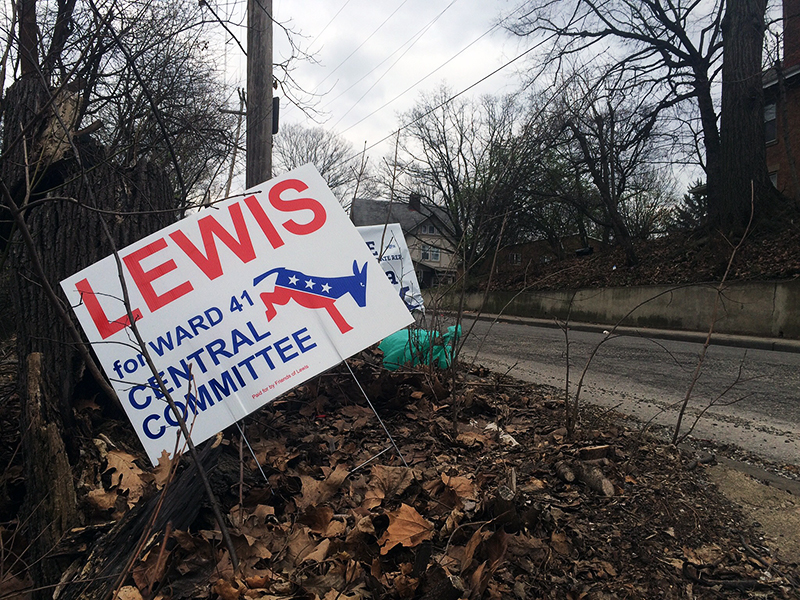 Signs from Evan Lewis's campaign were posted near the Iuka and Waldeck avenues. Credit: Nick Roll | For The Lantern