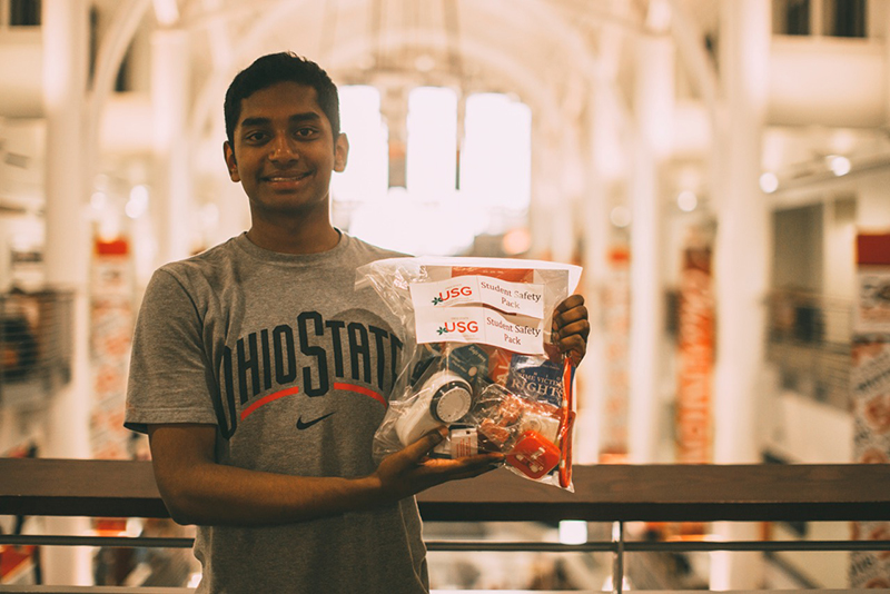 Sunder Sai, a second-year neuroscience, shows the Student Safety Packs, which will be available during the town hall on April 12. Credit: Courtesy of Nathan Loos