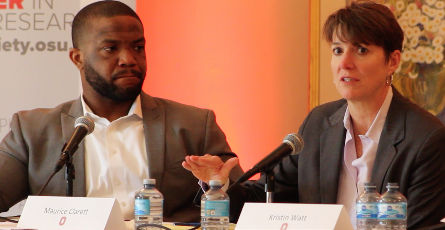 Former OSU basketball player Kristin Watt (right) speaks at a forum about paying college athletes while former OSU running back Maurice Clarett (left) listens. Credit: Mitch Hooper | Lantern reporter
