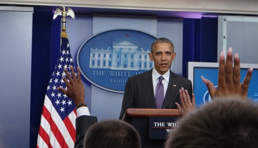 Collegiate reporters raise their hands to ask President Barack Obama questions in the White House's James S. Brady Press Briefing Room on College Reporter Day, April 28.