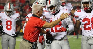 OSU cornerback coach Kerry Coombs and then-freshman cornerback Denzel Ward (12) celebrate after a tackle by Ward during a game against Rutgers on Oct. 24 at High Point Solutions Stadium in Piscataway Township, NJ . Credit: Lantern file photo