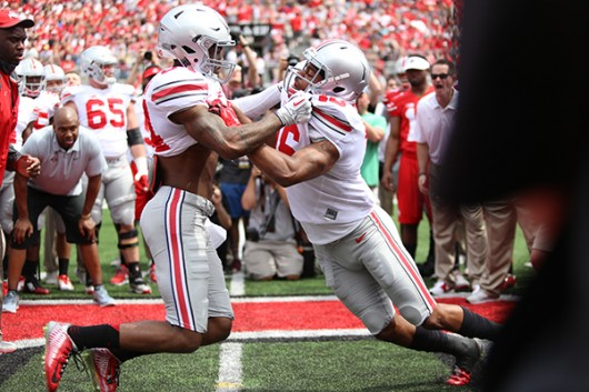 OSU then-redshirt junior Corey Smith (84) and then-sophomore Cam Burrows (16) face off during the 2015 Spring Game on April 18 at Ohio Stadium. Credit: Lantern File Photo
