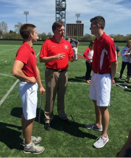 Director of Marching and Athletic Bands Christopher Hoch (center) speaks with incoming head drum major John LaVange (left) and incoming assistant drum major Konner Barr (right) at the Harmon Family Football Park on April 24 after the two students were named to their respective positions. Credit: Michael Ittu | For The Lantern