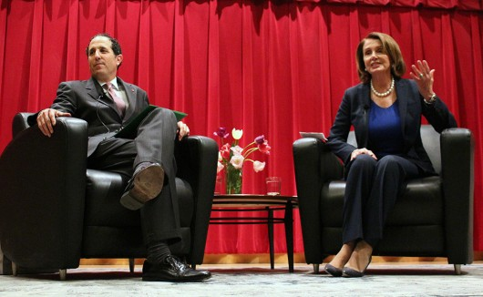 Moritz College of Law dean Alan Michaels (left) and House Minority Leader Nancy Pelosi (right) speak at Saxbe Auditorium on April 22. Credit: Michael Huson | Campus Editor