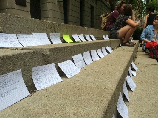 #ReclaimOSU protesters leave notes on the steps of Bricker Hall at Ohio State on April 26. Credit: Nick Roll | For The Lantern