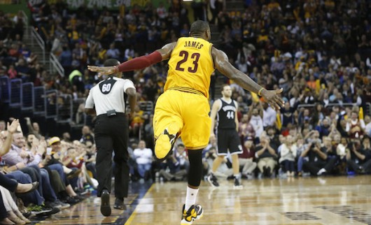 LeBron James of the Cleveland Cavaliers runs down the court after dunking against the Brooklyn Nets during a game at Quicken Loans Arena in Cleveland on March 31. Credit: Courtesy of TNS