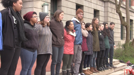 Students sing together outside Bricker Hall after delivering a statement regarding their treatment during Wednesday's night #ReclaimOSU sit-in. Faculty members also read a letter of solidarity. Credit: Hannah Herner | Assistant Arts&Life Editor