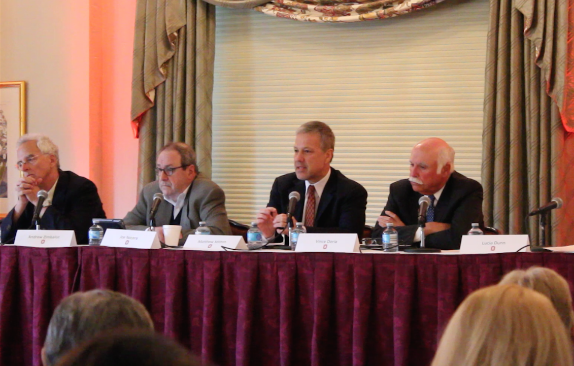 Vince Doria (far right), Matt Mitten (second from right), Joe Nocera (second from left), and Andrew Zimbalist (far left) are introduced on Friday at the Sports Society Initiative's forum on paying college athletes. Credit: Mitch Hooper | Lantern reporter