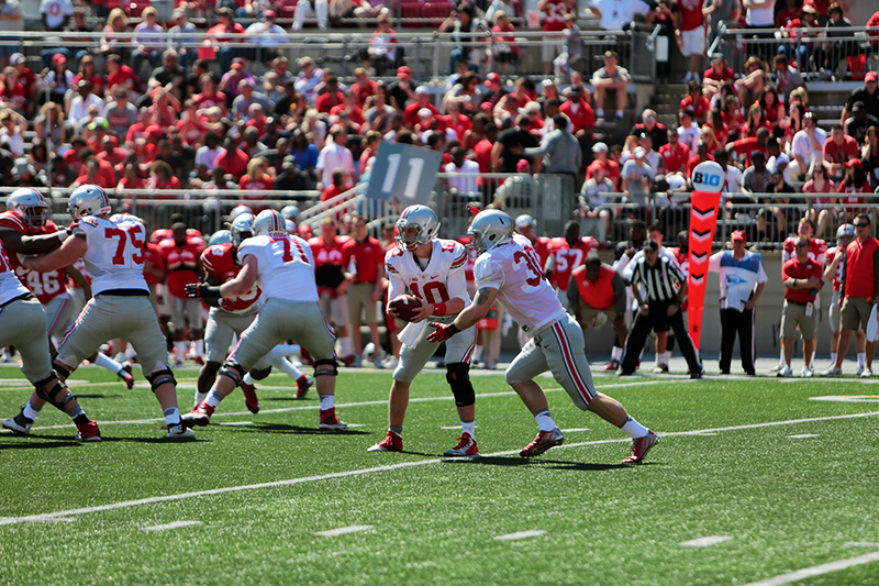 OSU redshirt freshman quarterback Joe Burrow (10) hands the ball off during the spring game on April 16 at Ohio Stadium. Credit: Muyao Shen | Asst. Photo Editor