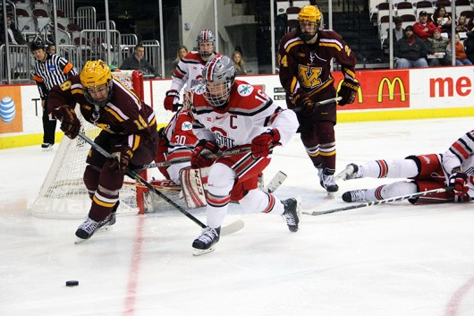 Former OSU forward Tanner Fritz (16) chases the puck during a game against Minnesota at the Schottenstein Center on March 6, 2015. Credit: Lantern File Photo