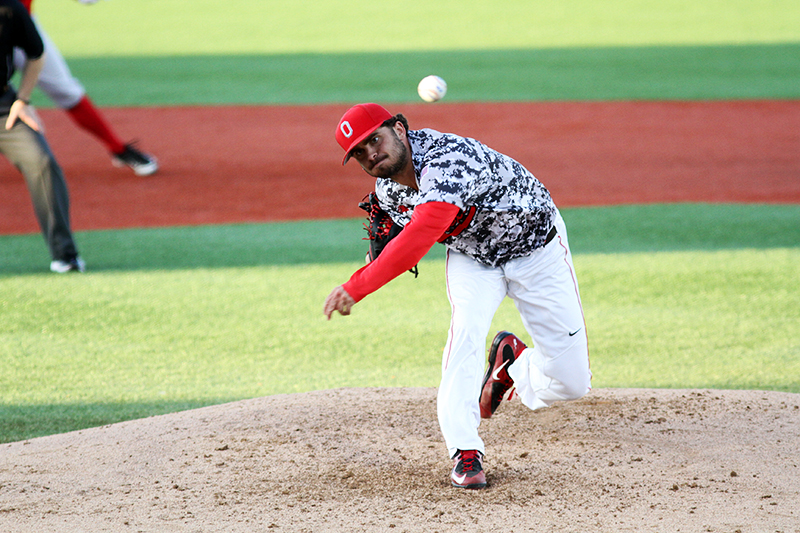 Junior left-hander Tanner Tully fires a pitch during a game against Rutgers on April 15 at Bill Davis Stadium. Credit: Samantha Hollingshead | Photo Editor