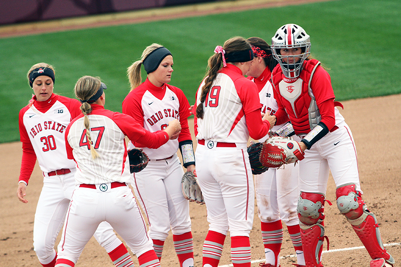 OSU softball players during a game against Penn State on April 6 at Buckeye Field. Credit: Samantha Hollingshead | Photo Editor