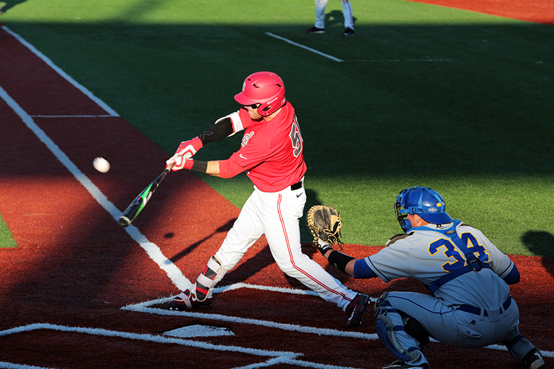 OSU senior second baseman L Grant Davis (50) hits the ball during a game against Morehead State at Bill Davis Stadium on April 13. OSU won 7-3. Credit: Muyao Shen | Asst. Photo Editor