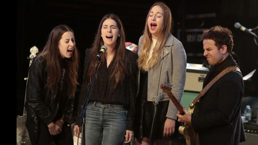 The Haim sisters (from left: Alana, Danielle and Este) and Taylor Goldsmith of Dawes perform in the New Basement Tapes band at the Montalban Theatre in Hollywood on Nov. 13, 2014.