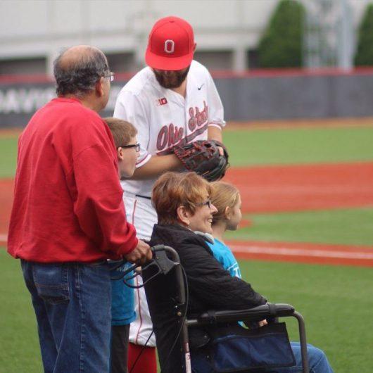 Jake Brobst (14) greets the Martinez family on May 3, ALS Awareness night at Bill Davis Stadium. Courtesy: OSU Athletics