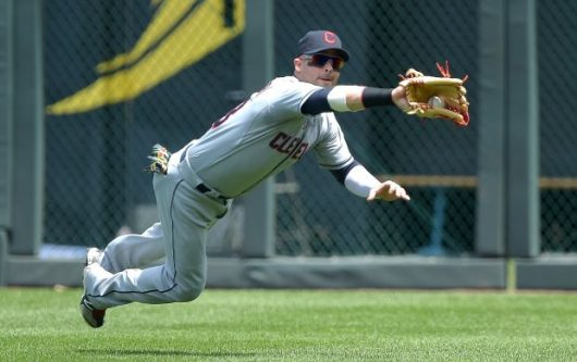 Nick Swisher makes a diving catch against the Kansas City Royals on July 27, 2014. He then played for the Cleveland Indians. Courtesy: TNS