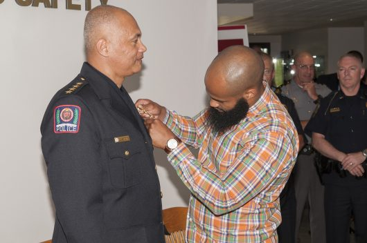 Craig Stone's son pins a medal on his father during a ceremony for the newly minted chief of the Ohio State Division of Police. Stone became the chief of police in May, and the pinning ceremony was held on Tuesday, June 7.