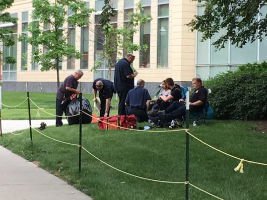 A woman sits with first responders after leaving the Chemical and Biomolecular Engineering and Chemistry building. Credit: Jacob Myers | Asst. Sports Editor