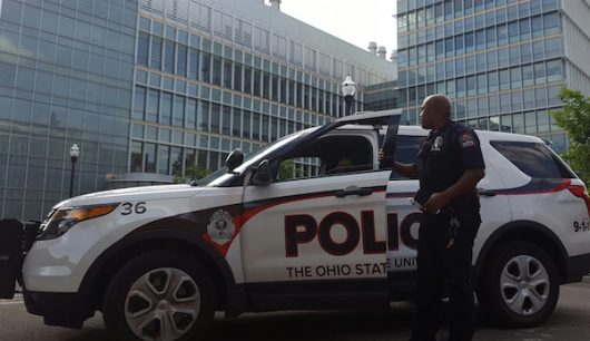 An Ohio State University police officer blocks off the road during an incident at the Chemical and Biomolecular Engineering and Chemistry building. Credit: Michael Huson | Managing Editor for Content