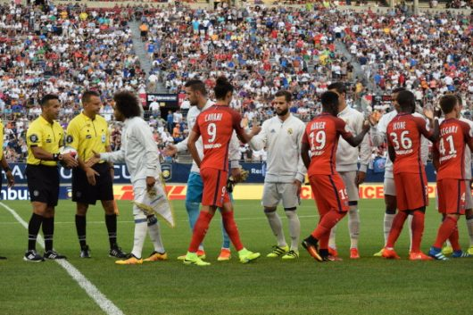 PSG and Real Madrid meet at center pitch before the International Champions Cup friendly at Ohio Stadium on July 27, 2016. Credit: OSU Athletics