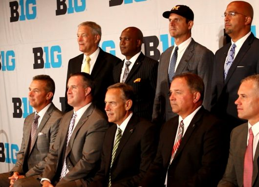 Urban Meyer (far left) joins other coaches of the Big Ten conference for photos at the 2016 Big Ten Media Days. Credit: Courtesy of Colin Hass-Hill | Lantern TV assistant sports director