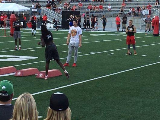Ohio State 2018 quarterback target Emory Jones (center) participates in drills with current Buckeye quarterback Joe Burrow watching.